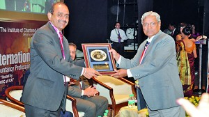 CA Sri Lanka President Mr. Sujeewa Rajapakse being presented with a token of appreciation