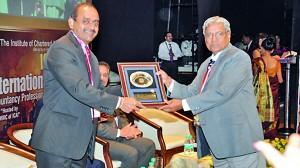 CA Sri Lanka President Mr. Sujeewa Rajapakse being presented with a token of appreciation