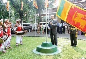 Ambassador Major General (Retd) Nanda Mallawaarachchi hoisting the national flag