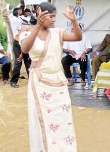 A gypsy woman dances at the event in Nochchkulam