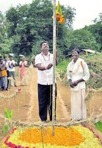 Vavuniya Municipal Council member Lalith Jayasekera hoisting the flag
