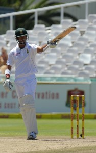 Robin Peterson raises his bat after scoring a half century during day 3 of the second test between South Africa and Pakistan at Newlands in Cape Town on February 16, 2013. AFP