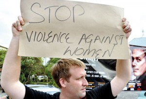 As  part of the 'one billion rising' global campaign to raise awareness over crimes against women held on February 14, a protest was held at  Lipton's Circus in Colombo. Here a foreigner is seen doing his bit.  Pic by Amila Gamage
