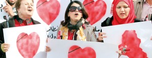 Iraqis women take part in Valentine's Day rally in Baghdad's Tahrir Square calling for better public services and for a corruption-free on February 14, 2013.  A organizer said they were calling on their leaders to love the war-battered country rather than rob its resources. AFP/Ahmad al-Rubaye