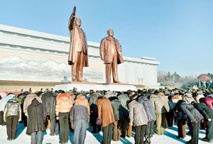 North Koreans bow in front of statues of North Korea founder Kim Il-sung (L) and late leader Kim Jong-il at Mansudae in Pyongyang on the birthday of their late leader, Kim Jong-il. Reuters