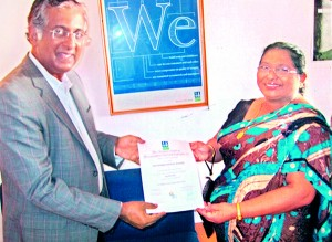 Mr. Nandakumar Shamanna, Zonal Chair of DNV BA South India & Sri Lanka, presents the ISO Certificate to Chairperson, Mrs Nirmalie Saparamadu of OKI International School, Wattala on 8th January 2013