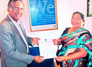 Mr. Nandakumar Shamanna, Zonal Chair of DNV BA South India & Sri Lanka, presents the ISO Certificate to Chairperson, Mrs Nirmalie Saparamadu of OKI International School, Wattala on 8th January 2013