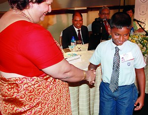 Handing over of the first Commom Identity Card by Ms. Kumari Hapugalle Perera