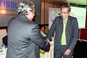 Founder President, Dr. Frank Jayasinghe handing over plaque to Mr. Kingsley Jayasinghe, Principal, Wycherley International School