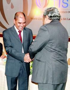 Dr Harsha Alles  handing over the first plaque to Founder President, Dr. Frank Jayasinghe