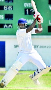 Thilina Silva of St.Benedicts square cuts on his way to hit 75