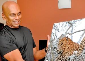 Dr. Harin displays one of his many leopard shots. Pic by Indika Handuwala
