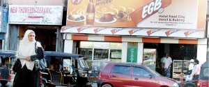 A shop hoarding bearing the assurance that it serves 'halal' products. Pic by Nilan Maligaspe