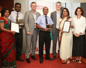 ICBT Campus staff proudly posing with awards together with British Council officials