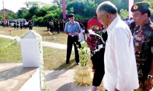 Indian High Commissioner Ashok Kantha who visited Jaffna yesterday laying a wreath at the IPKF memorial as Sri Lanka called off a mid-sea protest against Indian poaching. Pic by N. Parameshwaran