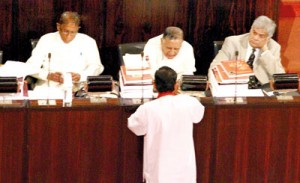 Govt. has no respect for Constitutional rule: Wickremesinghe (right) in Parliament