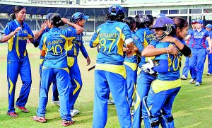 Lankan lasses celebrate their inaugural World Cup victory against England.