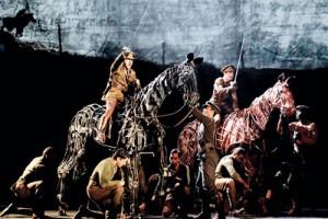 A scene from War Horse: Sanjit (second from left kneeling) is the foreleg puppeteer. Pic by Paul Kolnik