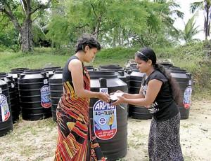 Ayesha Perera presenting a water tank