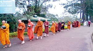 The monks on pindapatha and right, Ajahn Brahmali accepts alms