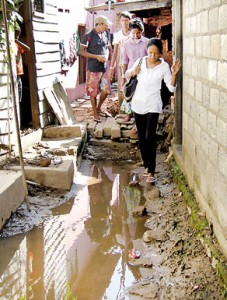 Stepping out from her shanty dwelling