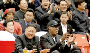 New pals: North Korean leader Kim Jong Un, left, and former NBA star Dennis Rodman laugh and cheer at they watch North Korean and U.S. players during a game in Pyongyang