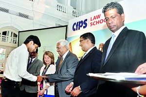 Mr.A.S.M. Perera Awarding the Scholarship for one of the  Scholarship winners.