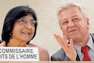 U.N. High Commissioner for Human Rights Navi Pillay listens to Remigiusz Henczel, President of the Human Rights Council before delivering her annual report to the 22nd session of the Human Rights Council at the United Nations in Geneva REUTERS