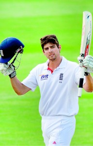 England's captain Alastair Cook celebrates 100 runs during day four of the first international cricket Test match against New Zealand at the University Oval park in Dunedin. - AFP
