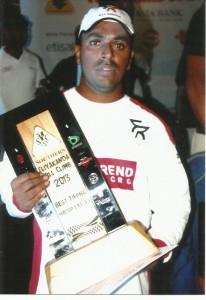 Ashan Silva with his fourth Eliyakanda Hill Climb trophy.