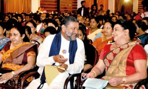 Sharing a light moment: The First Lady with Minister Karaliyadda at the event at Temple Trees.  Pic by Indika Handuwala