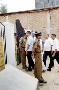 Some of the suspects are seen walking into the Valaichchenai Magistrate Court. Pic by Deva Adiran