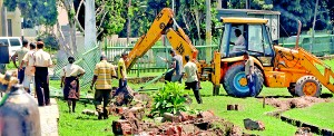 CMC workers working on the 'beautification' of the city. Pic by Mangala Weerasekera