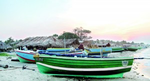 "Boats lie idle on Karainagar beach to mark ""turn naal""—or turn day."