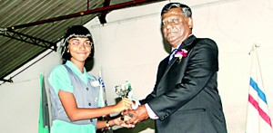Lyceum Nugegoda Scrabble captain Sewmini Pieris�receiving the Overall Runners-up Trophy.