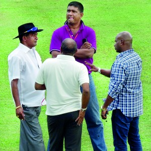 Just look at this foursome�.. Jayananda Warnaweera (Curator), Pramodya Wickremasinghe, Sanath Jayasuriya, Hashan Tillekeratne – the three stalwarts of the selection panel -- seem to be in deep discussion as how the curator missed the right clarity of top soil on the Galle wicket for the first test. This prize picture was captured by our Daily Mirror Sports editor Channaka de Silva.