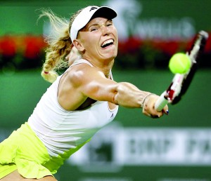 Caroline Wozniacki of Denmark lunges for a shot while playing Angelique Kerber during the BNP Paribas Open at the Indian Wells Tennis Garden on March 15, 2013 in Indian Wells, California.