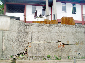 Total damage: The foundation and parapet walls around the house cracked and broken