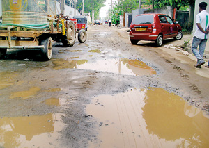 Roads are left in a  state of disrepair as construction work continues