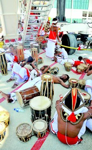 Dead beat: Traditional drummers  find a cool spot away from the heat