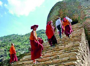A group of monks from Bhutan visit an archaeological site to offer their religious rituals in Pakistan's northwestern Swat Valley (AFP)