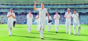 England's Steven Finn leads England off after equalling his best figures