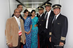 Seen here Captain Milinda Ratnayake (right), who piloted the first commercial flight – SriLankan Airlines from Dubai to Colombo via Mattala- , at the airport along with other pilots, stewardess and officials. A group of 40 passengers from the US  (via Dubai) got off at Mattala.