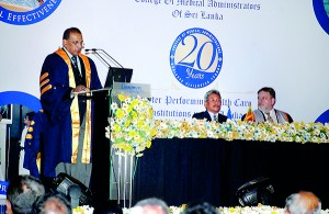 Surgeon Rear Admiral N.E.L.W. Jayasekera delivering the presidential address at the 20th annual scientific sessions of the College of Medical Administrators of Sri Lanka. At the head table are Defence Secretary Gotabaya Rajapaksa and Dr. Roger Boyd, Chair of the World Federation of Medical Managers