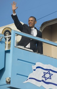 Obama waves from the steps of Air Force One prior to departing from Ben Gurion International Airport in Tel Aviv. AFP