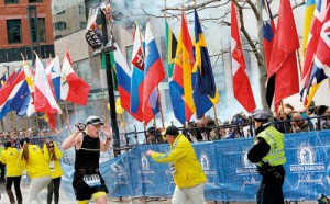 Police and runners react to an explosion during the Boston Marathon finish area in Boston, Massachusetts, April 15.  Two simultaneous explosions ripped through the crowd at the finish line of the Boston Marathon on Monday, killing three  people and injuring dozens on a day when tens of thousands of people packed the streets to watch the world famous race. REUTERS