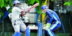 Sampath Bank's Kaushal Silva is clean bowled.