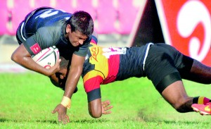 The Number 12s of S. Thomas' and Trinity collide in their traditional rugby encounter played at Havelock Park in Colombo yesterday. - Pic by Amila Gamage