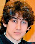 Boston bombers: Dzhokhar Tsarnaev (left) graduated from his Cambridge high school and was in college studying medicine. His brother Tamerlan (right) was killed after they were named terror suspects (Daily Mail)