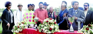Winning owner of  the Sunquick Cup C.R. Rajapaksa receiving the trophy from chief guest Tommy Ellawala, Chairman C.W. Mackie PLC who were the sponsors of the horse racing meet. - Pix by Ranjith Perera